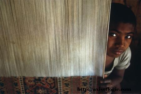 Child Weaving Rug