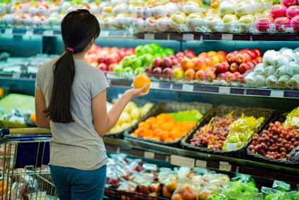 Woman Choosing Fruit