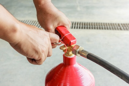 Pulling Out Pin on Fire Extinguisher