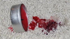 how to get candle wax of a carpet
