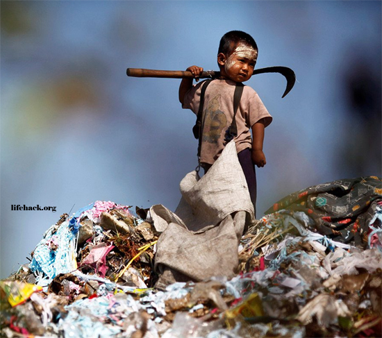 Young child collecting plastic at a rubbish dump in Thailand