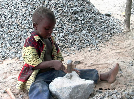 4 year old child working at excavation site