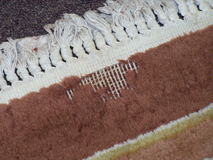 Oriental rug with moth damage