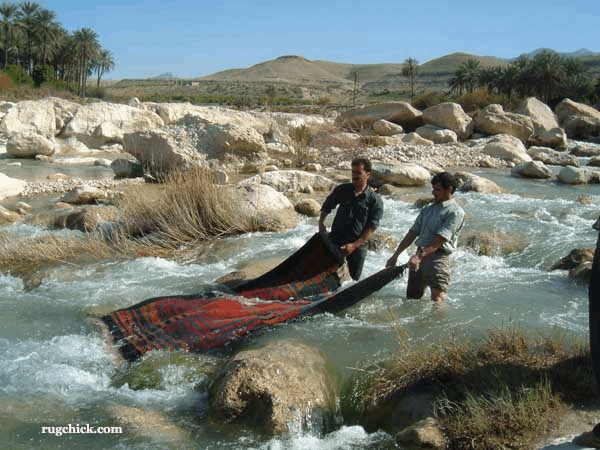 Washing Rugs in the River