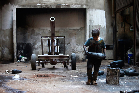 Boy working in a weapons factory in Aleppo