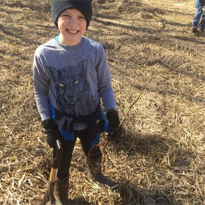 Boy Planting Trees