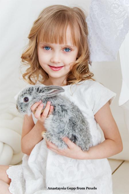 Child with Pet Rabbit